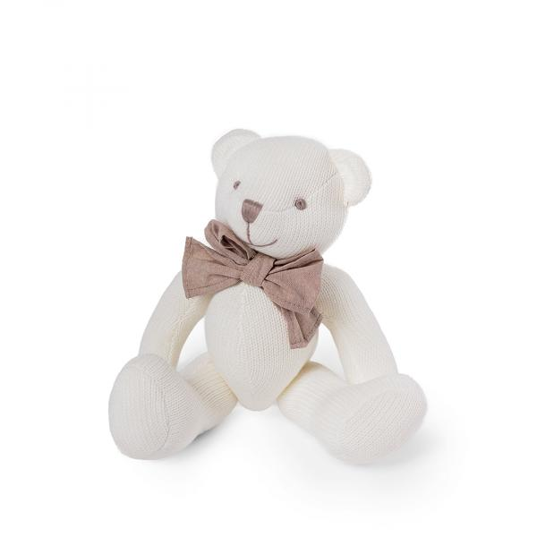 Knitted teddy bear with bow